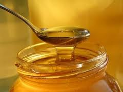 Our honey is strained once to remove solids.  It will keep indefinitely if kept sealed.
